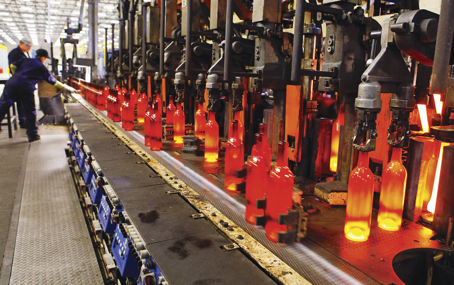 Glowing red-hot wine bottles are coming off the line at the Bennu Glass plant in Kalama, WA. on August 3, 2012. (AP Photo, The Daily News, Bill Wagner )